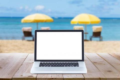 A laptop on a beach