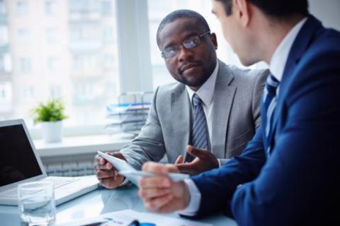 A hiring manager and a financial consultant talk business.