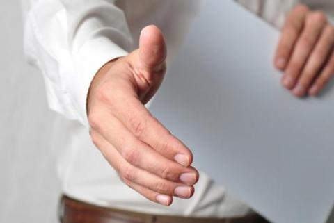 An extended hand ready for a handshake