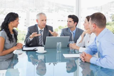 Manager holds a staff meeting with his multigenerational team