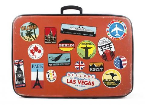 A suitcase with travel stickers