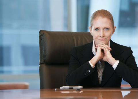 Female executive sitting at desk