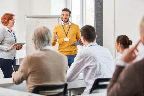 A trainer gives professional development to company employees