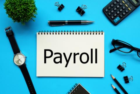 Kick-off a Career in Payroll - notebook with payroll written on it