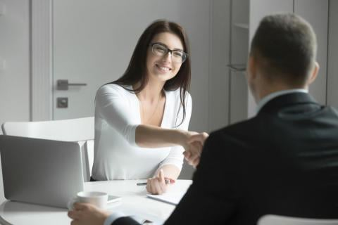 "Two people shaking hands before one shows how to answer, ""Tell me about Yourself"""