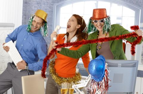 Employees celebrating the holidays at the office party
