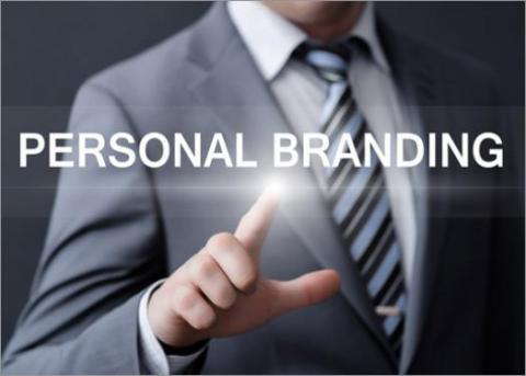 "Man's suited torso pointing at ""PERSONAL BRANDING"""