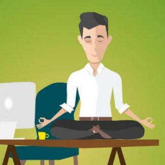 Man meditating on desk