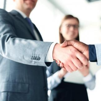 Handshakes representing successful hiring trends in the workplace