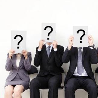 Job applicants holding question marks to ask in an interview