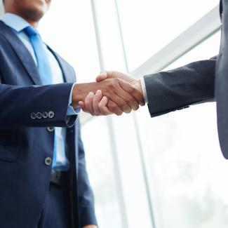Recruiter shaking hands with a new client
