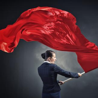 Business Woman Holding Red Flag