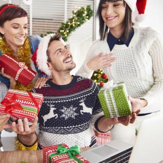 Employees exchanging holiday gifts at the office