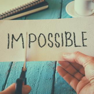 Cutting the word impossible to say possible