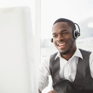 How to Hire Customer Service Representatives — man with headphones at computer