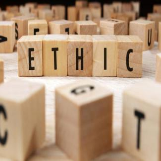 "Scrabble tiles spell ""ETHIC"""